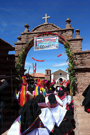 Inka Kullis dancers entering main square at San Santiago festival , Taquile Island , Peru