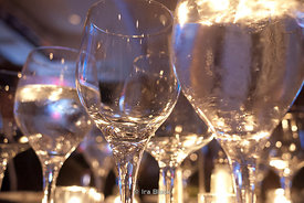 Wine glasses on a table at a party.
