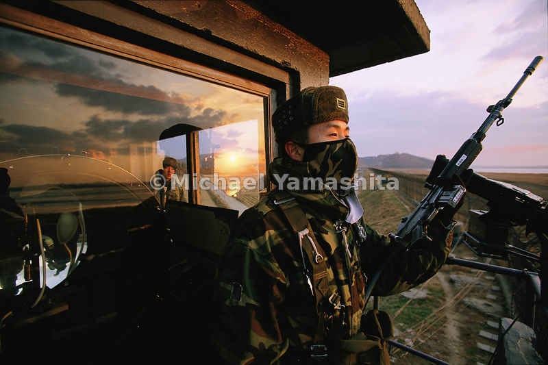 Scanning for infiltrators from North Korea, South Korean soldiers defend the Demilitarized Zone, where escalating tensions keep troops on high alert.
