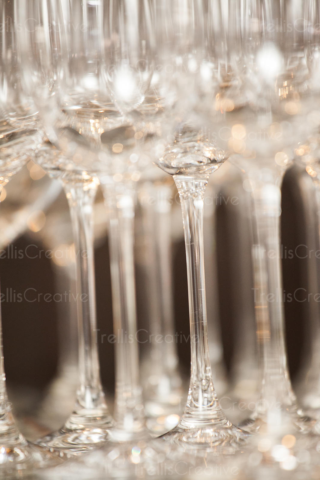Rows of empty champagne flutes neatly lined up
