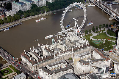 aerial photograph of London County Hall  Westminster Bridge Rd  London SE1 7JA England UK with  the London Eye behind