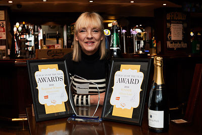 Alison Lund from The Waterloo has won publican of the year for Punch Taverns and was given a large bottle of Carling.