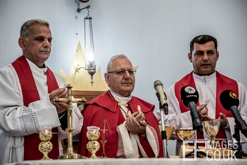 Holy Communion On Maundy Thursday With Mar Louis Raphael Sako, Head Of The Chaldean Church. Easter In Iraq