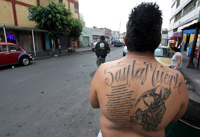 A faithful of the Santa Muerte in Alfarería street in the neighborhood of Tepito, Mexico City