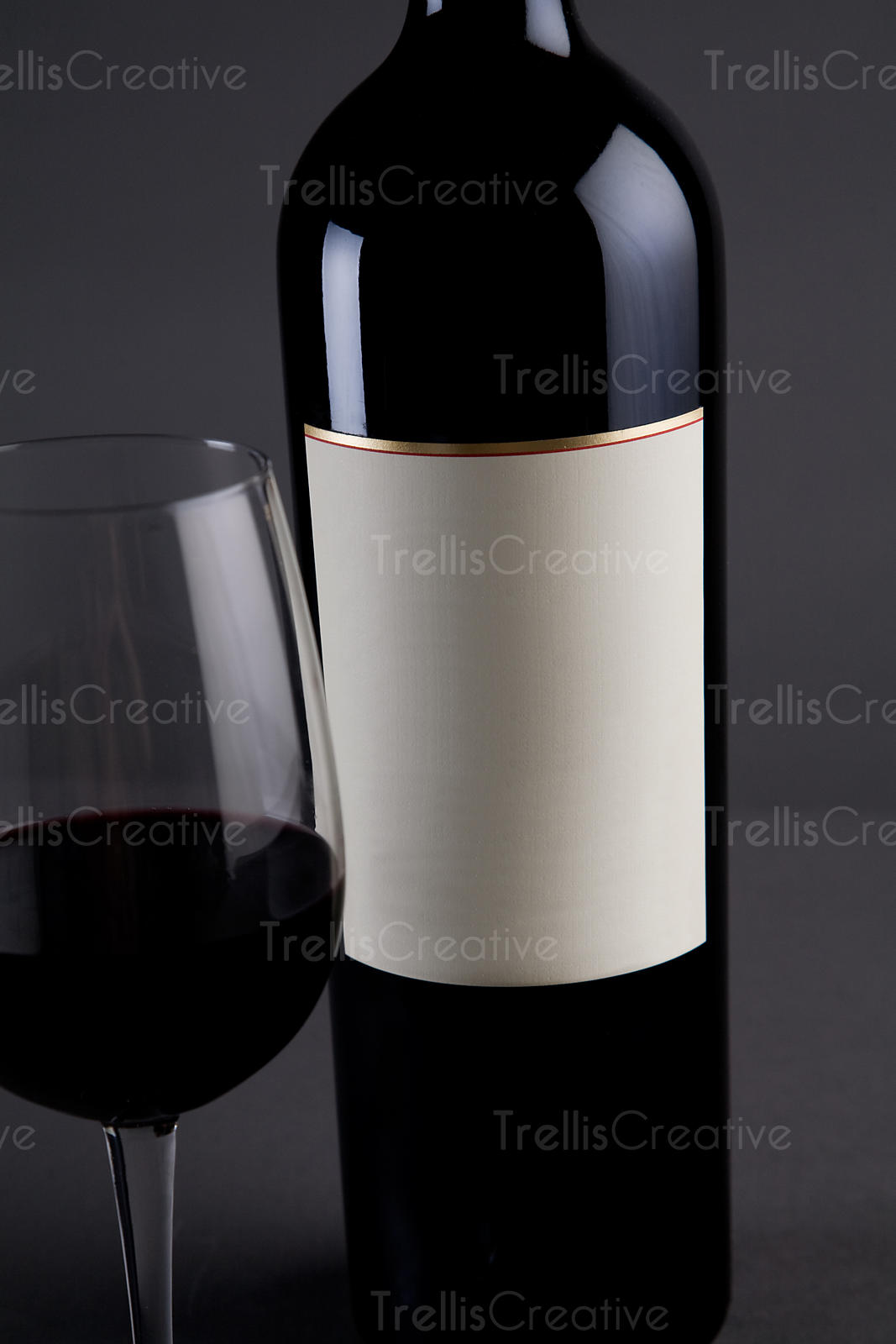 Red Bordeaux wine magnum bottle with cream colored blank label