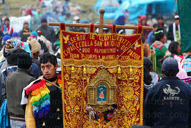 Devotee with embroidered banner during Qoyllur Riti festival, Peru