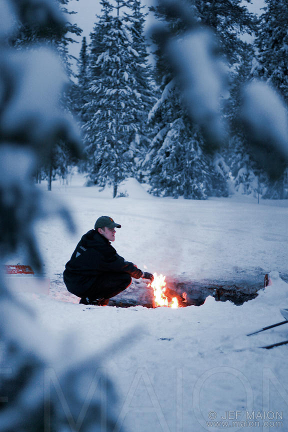 Man by campfire in the forest