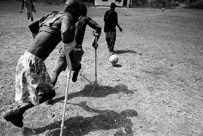 Members of an Amputee Football Team practice their game in Makeni