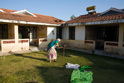 India - Cuddalore - Govindhamma, an elderly resident makes her way back to her room after lunch