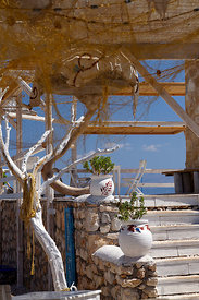 Taverna, Kania Beach, Chalki Island near Rhodes, Dodecanese Islands, Greece.