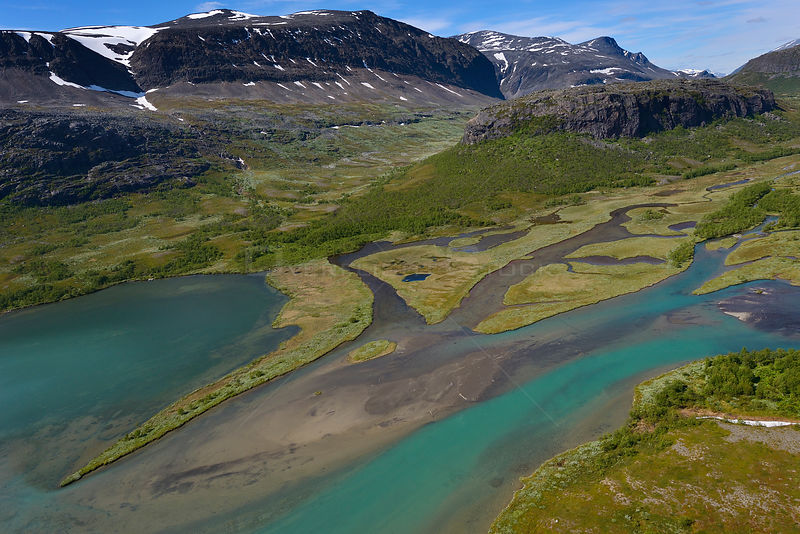 Aerial view of the Vietasatno river near its source with distant mountains, Stora Sjofallet National Park, Greater Laponia Rewilding Area, Lapland, Norrbotten, Sweden, June 2013.