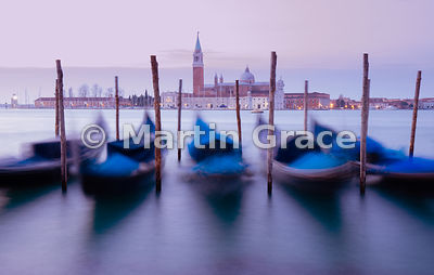 Dawn view of gondolas moving on the swell of Bacino di San Marco (St Mark's Basin), with San Giorgio Maggiore (church) beyond, Venice, Italy
