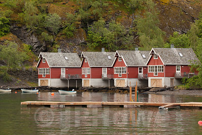 Traditional Red Houses in a row on the Waters Edge