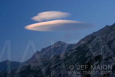 Lenticular cloud over mountain