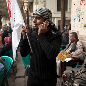 A man with a flag and others who have been protesting in Tahrir Square come and rest at the Zahrat al-Bustan cafe, Cairo