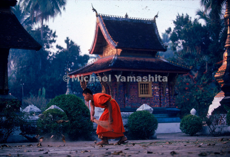 A monk sweeps the courtyard of Wat Xieng Thong as part of his morning ritual of chores in Luang Prabang, the old royal capital of Laos.