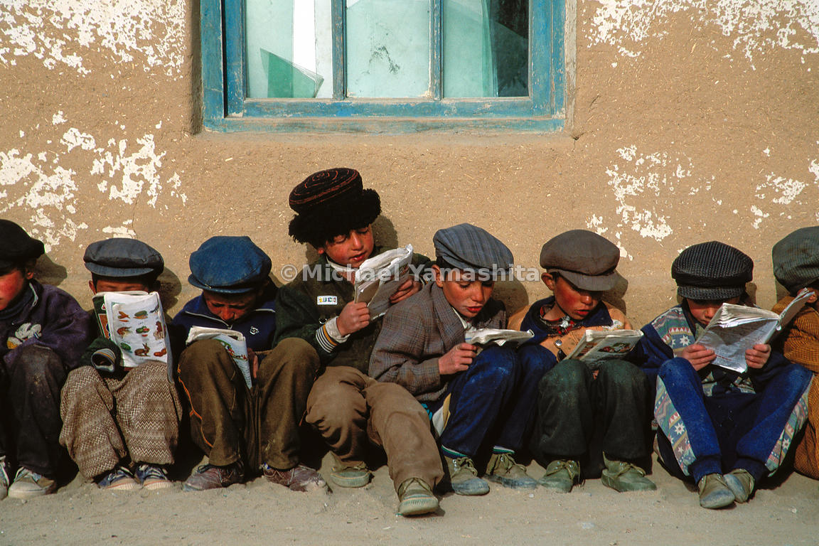 In this small village [Tiznot] near Taxkorgan, where all boys wear blue and girls wear red, these young students prepare for class.  Kashgar, Xinjiang, China
