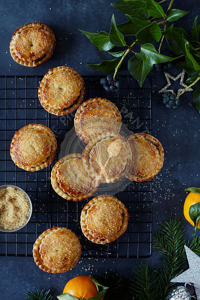 Mince Pies on cooling rack with festive styling