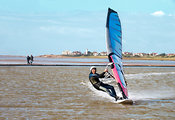 Windsurfer and walkers