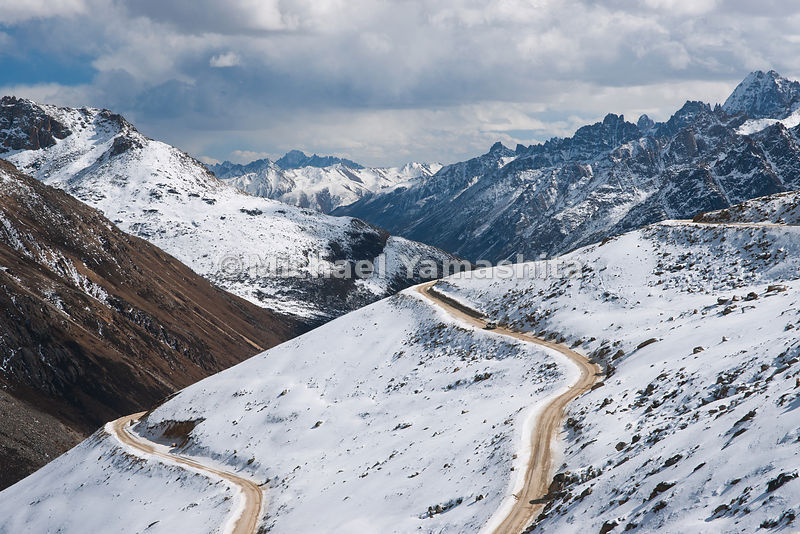 The road at the top of the 16,400 ft (5,100 m) Trola Pass, which lies between Dege and Manigango, is covered with snow for most of the year.