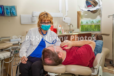 Woman dentist using a wheelchair in her examination room