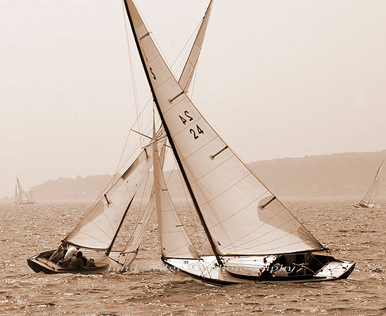 2 Herreshoff S-boats cross paths on their way to the windward mark at the 2004 Herreshoff Rendezvous in Bristol, RI.