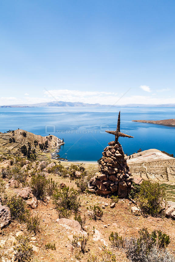 Cairn with cross on Isla del Sol, Lake Titicaca, Bolivia, December 2013.