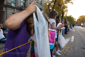 Lauraya checks her candy bag for how much she has acquired during the  University of Iowa homecoming Parade in Iowa City on Friday September 28, 2012. (Justin Torner/Freelance)