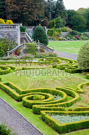 Box parterre in lower garden beneath terrace at front of house