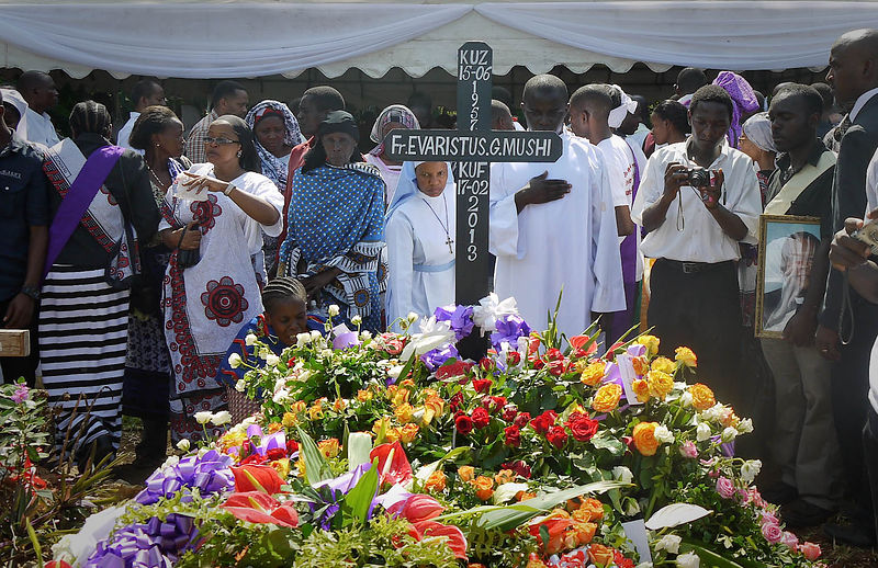 Mourners pay their last respects to Father Evarist Mushi in Kitope, Zanzibar, February 20, 2013. Father Mushi was blocked by two young men at the entrance of his church, and was shot in the head on February 17th, according to Mohammed Mhina, the island's police spokesman.