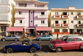 Old cars in front of a bar in Havana, Cuba
