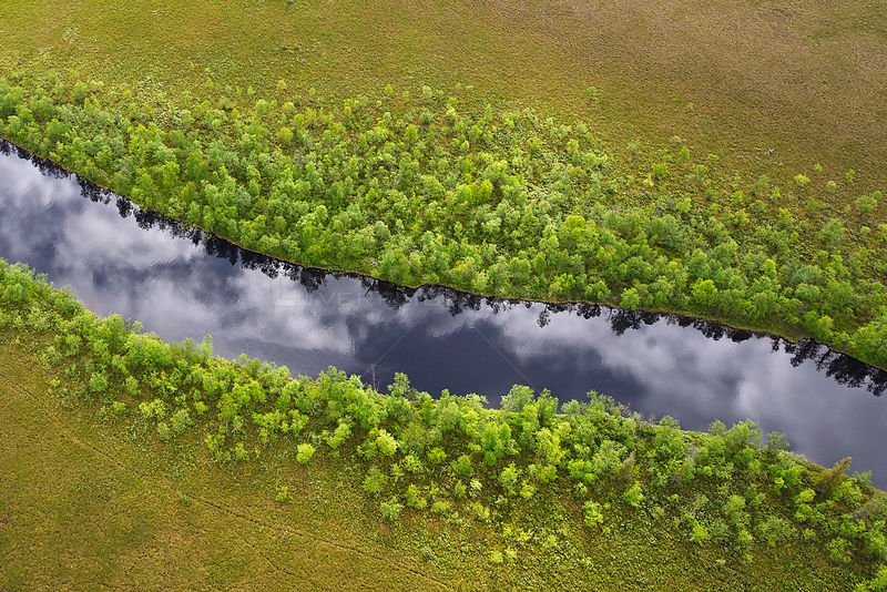 Aerial view of river with clouds reflected in water, Sjaunja Bird Protection Area, Greater Laponia Rewilding Area, Lapland, Norrbotten, Sweden, June 2013.