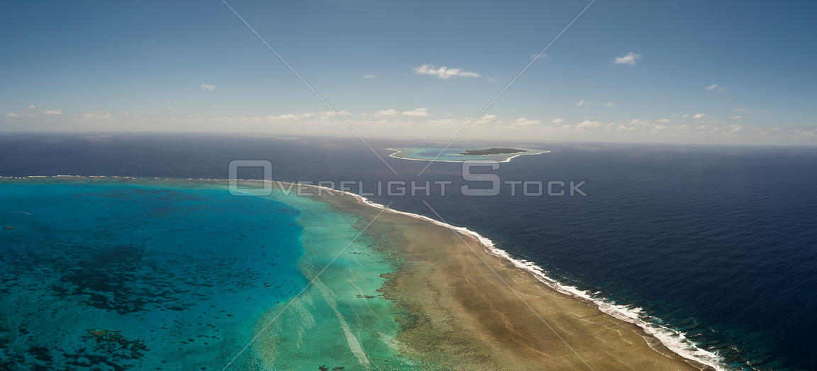 Aerial view of Vuata Vatoa Reef looking towards Vatoa Island, also known as Turtle Island by Captain Cook, Lau Island Group, Fiji.