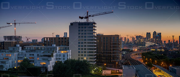 Construction Cranes at Royal Wharf and Train Station with Downtown London England