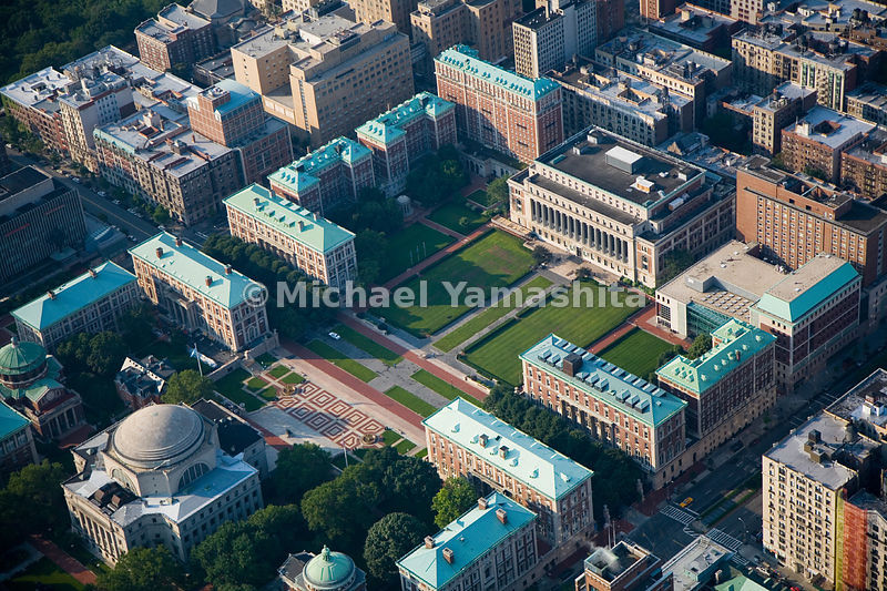 Columbia University, with its distinctive green rooftops, dominates Morningside Heights, and its two libraries, Lowe and Butler, are the focal points of the campus.  Manhattan, New York City.