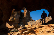 Hiker at Stadsaal caves, Cederberg Wilderness, South Africa