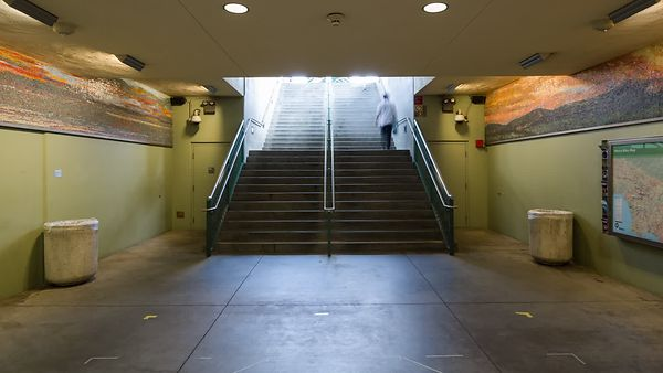 Medium Shot: Busy Public Staircase To Outside
