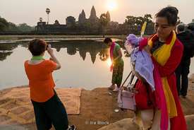 Tourists capture the sun rising over Angkor Wat, Cambodia.
