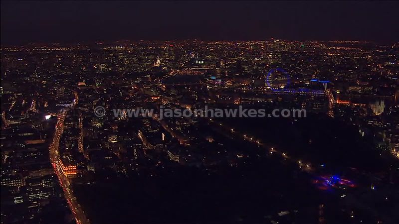 Aerial footage of the River Thames at night, London, England UK