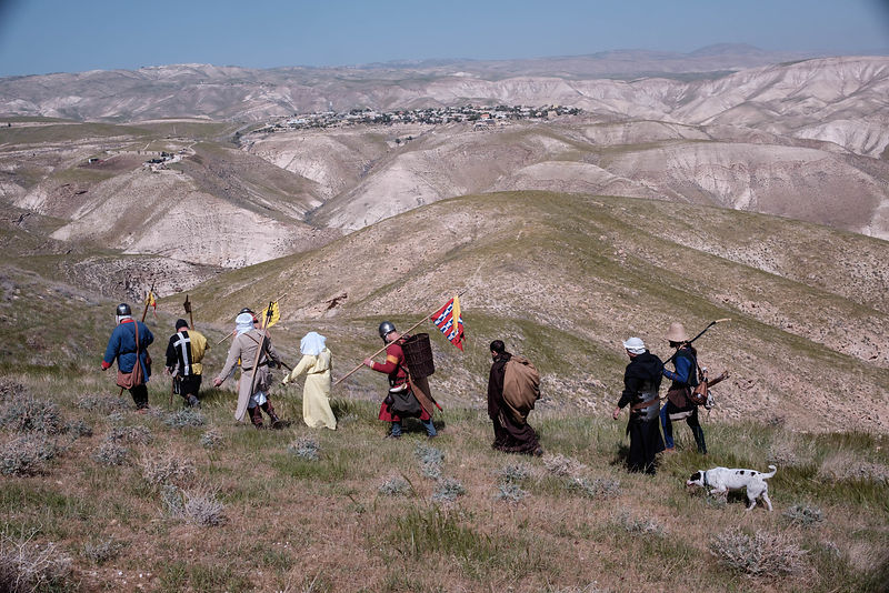 Israeli enthusiasts walk in the Jordan valley near Jericho as they take part in a three day walk between the West Bank city of Jericho and Jerusalem, on March 11, 2016.