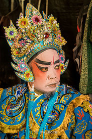 Traditional Chinese opera actors preparing before a performance in the Chinatown district of Bangkok, Thailand.  During the Chinese Vegetarian Festival .