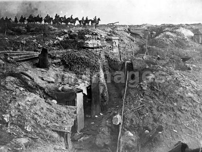 German soldiers on horseback view abandoned British trench