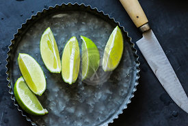 Lime wedges on a dark background