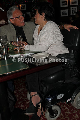 Woman in a power wheelchair on a romantic dinner date