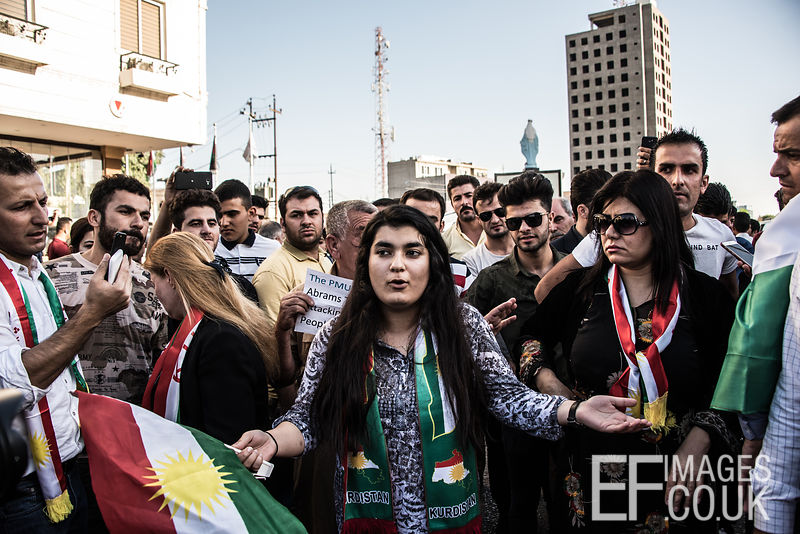 "Kurds displaced from Kirkuk by the ongoing conflict, between Iraq allied with Iranian backed Militia group Hashd al Shaabi and the semi autonomous Kurdistan region, protest outside the US Embassy in Erbil. They are asking where the international community was and why it didn't help them to keep Kirkuk. This girl speaks eloquently about her upset and feelings of betrayal, followed by chants of ""Death to America"" Erbil, Iraq"
