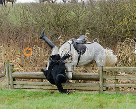 Harry Pepper falling at a hunt jump near Peake's Covert