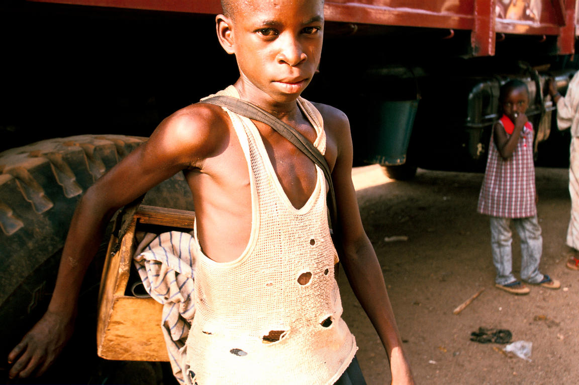 Ghana - Tamale - A street child who makes his living by shoe shining in the main market