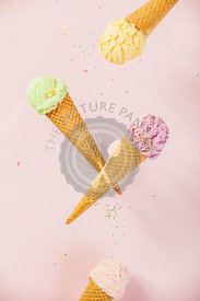 Colorful  Ice Cream in a waffle cones on pink background