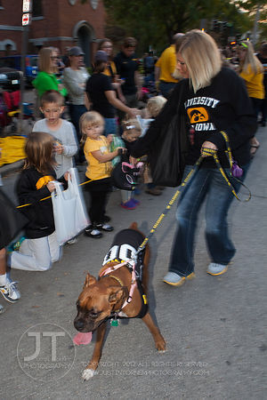 Erika Goedkin and her Boxer, Bella participate  in the  University of Iowa homecoming Parade on in Iowa City on Friday September 28, 2012. (Justin Torner/Freelance)