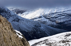 A cloud and snow covered Beinn Eighe in the Scottish Highlands, Scotland, UK.